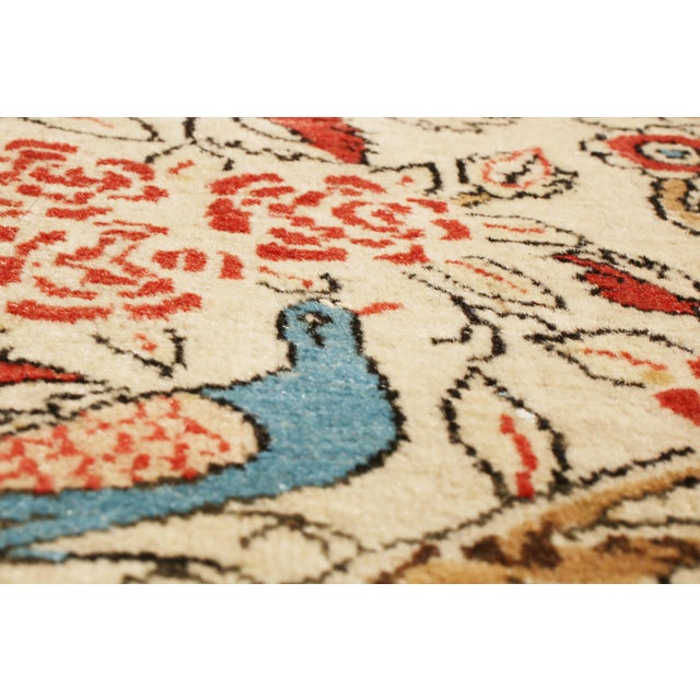 Hand knotted in high-quality wool originating from Persia in 1910, this antique Kashan Persian rug stands out among a...
