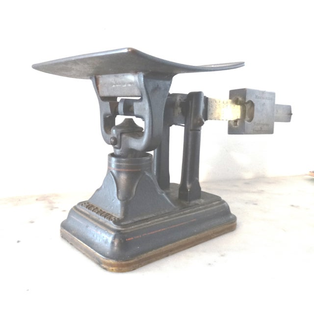 The brass beam has readings on both sides, calibrated to reflect postage rates of the time, up to 16 oz. weight. Solid...