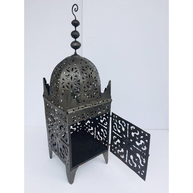 Moroccan Moorish metal candle lantern. Hurricane candle lamp handcrafted in Morocco by artisans, metal handcut and...