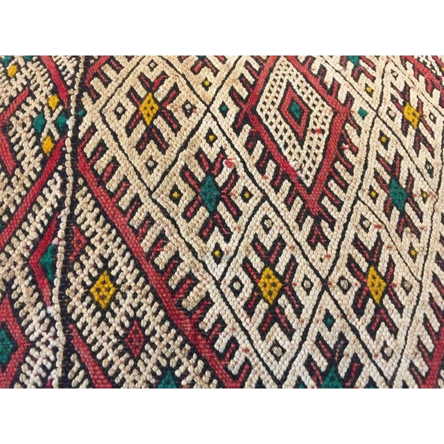 Moroccan Berber handwoven tribal throw pillow made from a vintage rug. The front and the back are made from a different...