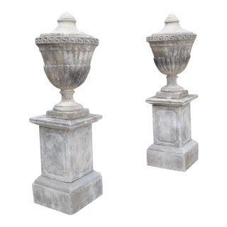 Pair of Neoclassical Composition Limestone Urns on Pedestals, Southern Italy For Sale