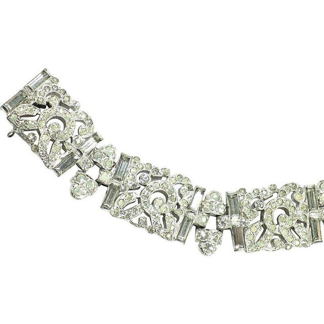Offered here is a KTF Trifari Art Deco rhodium-plated crystal link bracelet designed by Alfred Philippe, from the 1930s....
