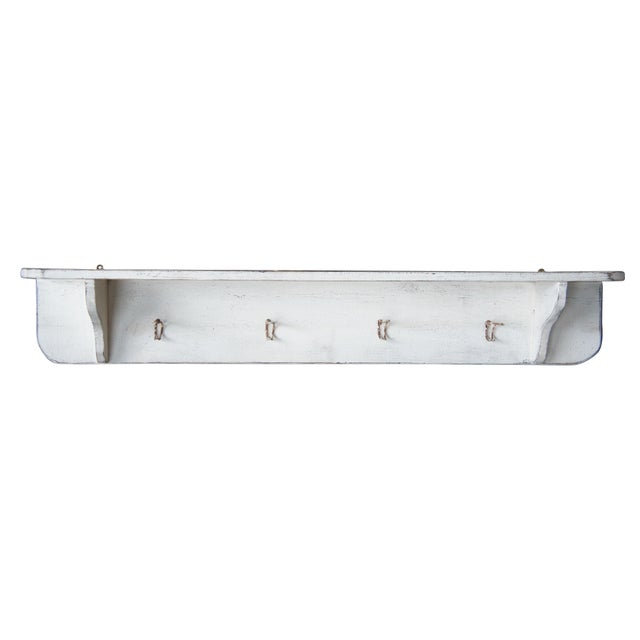 This beautiful coat rack is the perfect piece for any home. Country style with an antique white finish and 4 metal hooks....