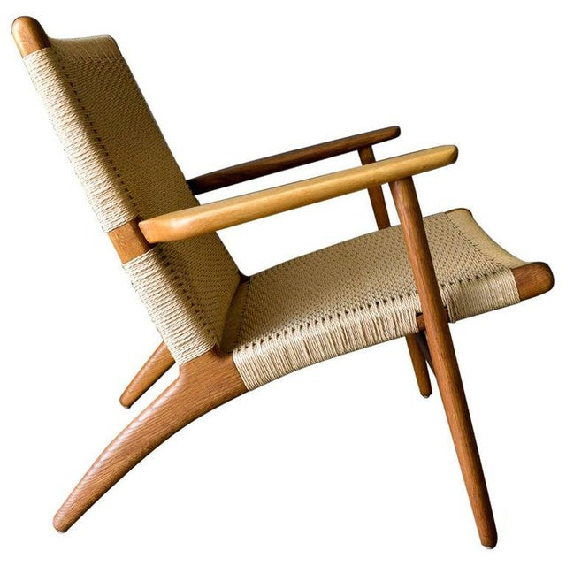 Hans Wegner for Carl Hansen & Son CH 25 lounge chair, circa 1950. Early model, marked on underside with stamp and Danish...