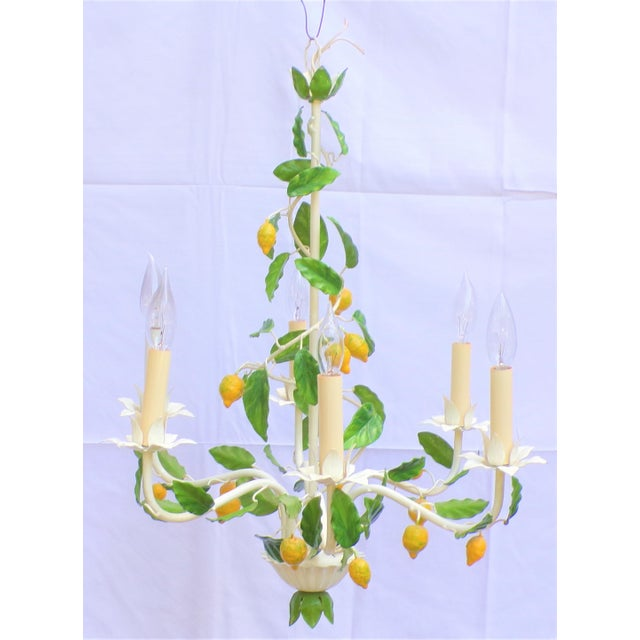 This is a vintage Italian Tole chandelier. circa 1950's This fixture has six-arm candle lights and it comes with the...