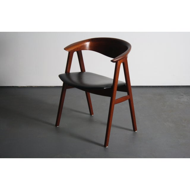 The seller says: Rare Erik Kirkegaard teak compass sculpted desk chair. This gorgeous chair is a must-have design piece!...