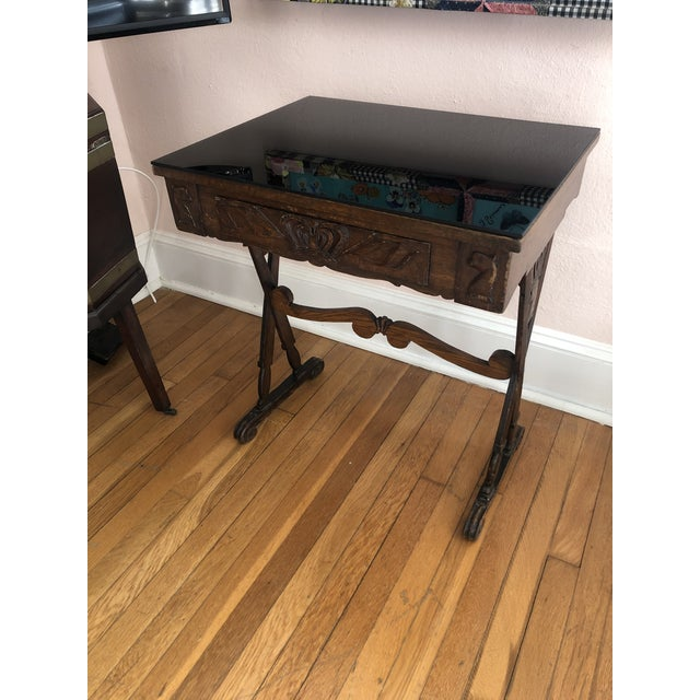A masculine wonderfully weathered carved oak end table having single drawer with crown decoration and two animal motife...