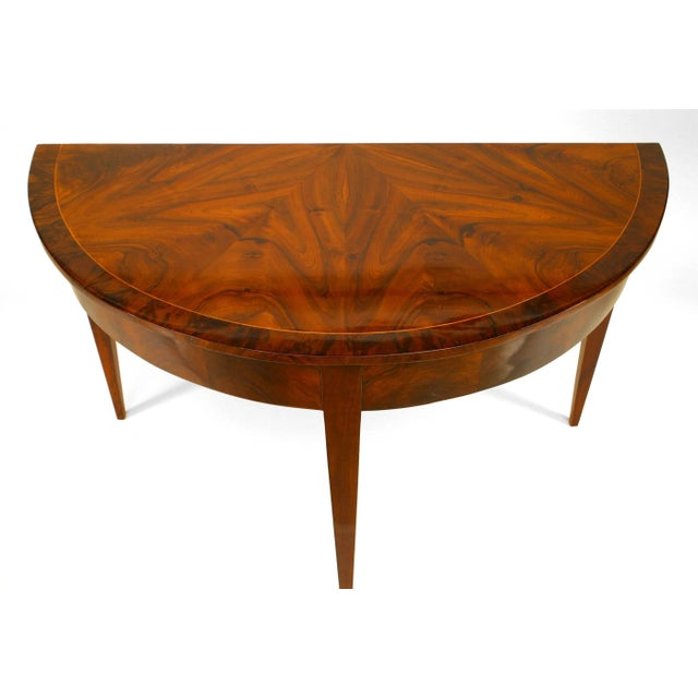 Pair of German Biedermeier circa 1830 demilune shaped console tables with book-matched walnut veneer and banded maple trim...