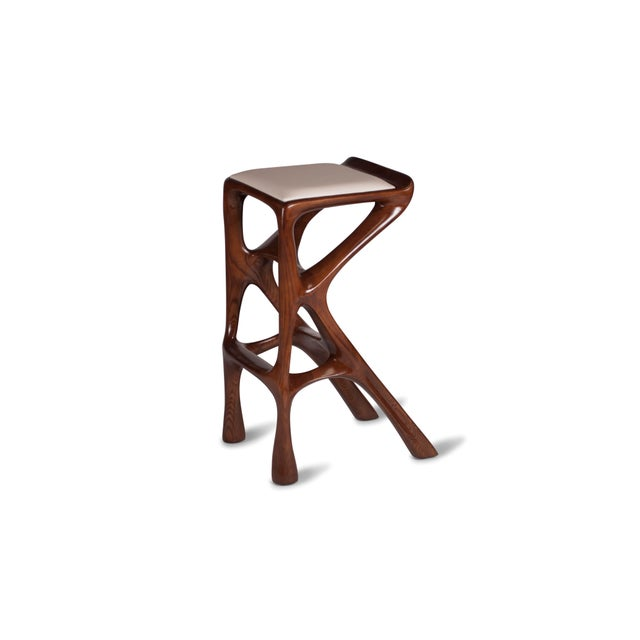 "Barstool designed by Amorph made out of solid ash wood and leather. Stain color: Rusted walnut Dimension 31"" H x 19.50"" L..."