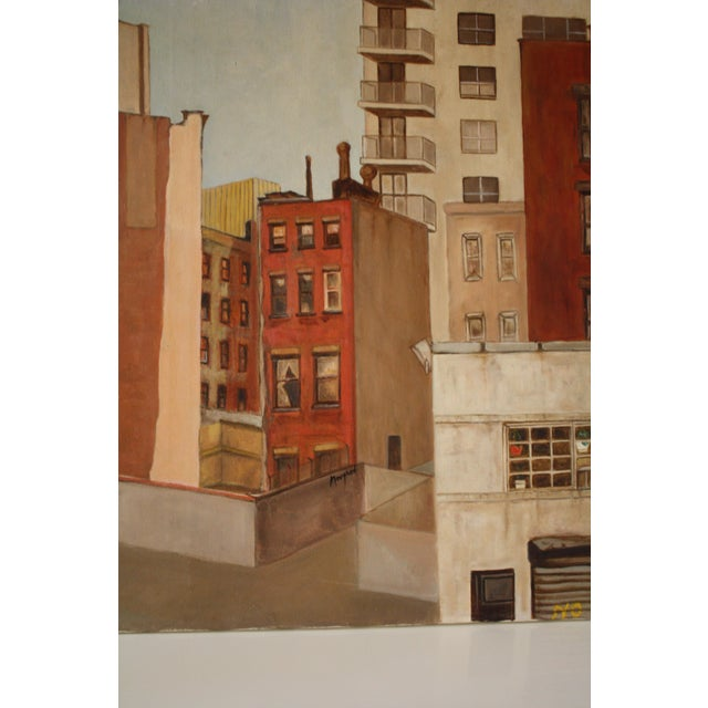 A large canvas cityscape painting, created in acrylic in warm tones. This piece was purchased at the Rose Bowl flea...