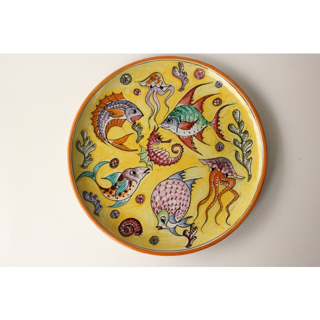 Offered is a vintage mid-century era Italian majolica style platter. This piece features a colorful, hand-decorated fish...