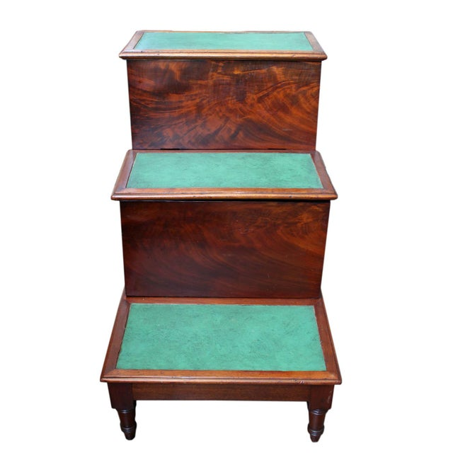 Mahogany library steps with leather inset steps fitted with commode drawers.