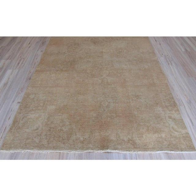 Oushak Turkish handwoven rare vintage tan color pure wool area rug. Made with 100% organic wool. It has been...