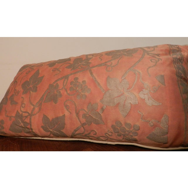 Pair of Fortuny lumbar pillows, the colors are a burnt orange with silver accents that are also reflective. The back of...