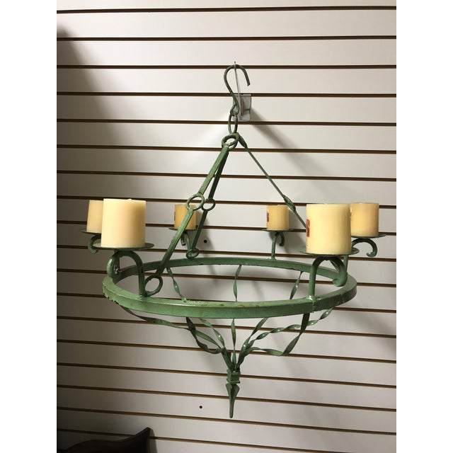 Hanging iron candle chandelier, nice green patina, candles included.