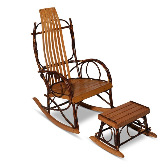 Handcrafted and signed by the maker, this rocker and footstool are classic examples of excellent Amish craftsmanship....