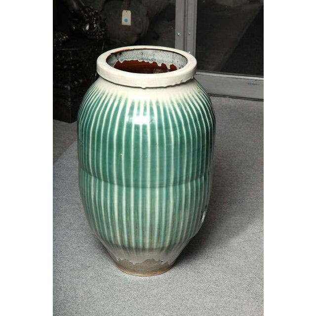 A classic 1870s large Japanese Shigaraki celadon glazed ceramic jar from the late Edo or early Meiji period. This...