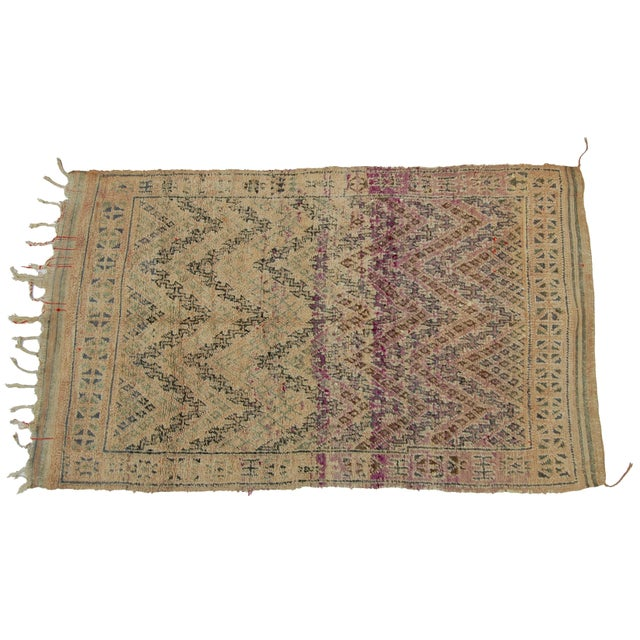 Vintage berber rug, featuring harlequin pattern in soft organic wool.