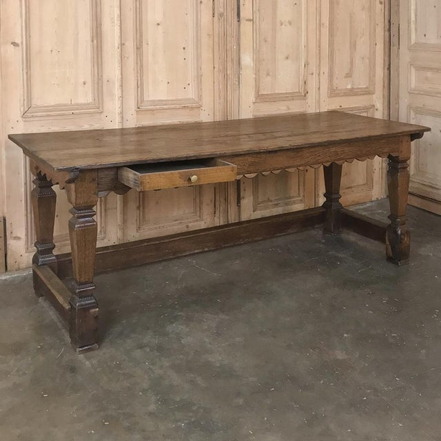 19th Century Rustic Oak Desk / Farm Table features a lovely scalloped apron, a single drawer for desk accouterments, and...