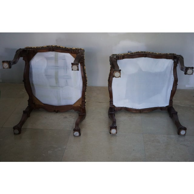 Ottoman style seats. Gorgeous fabric and attention to detail. Ornate wood legs.