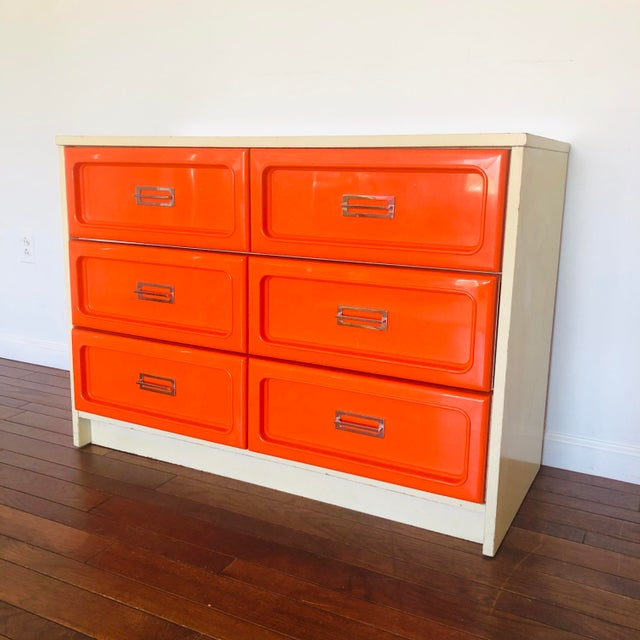 Space Age Pop Modernist Loewy influenced three double drawer dresser. Burnt orange mold injected plastic frontispieces...