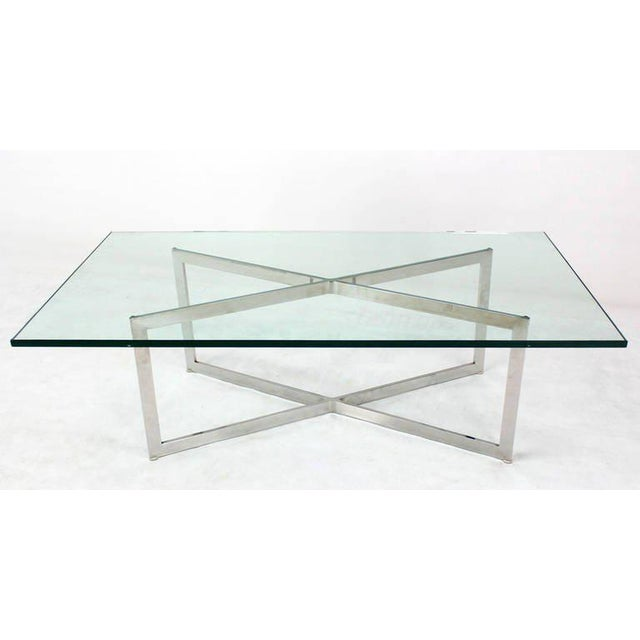 Nice mid-century modern glass top x-base rectangular coffee table. The frame is polished stainless steel.