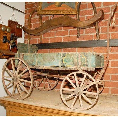 """This old wagon has distressed and worn painted elements. The name """"Climax"""" may be seen on one panel. We also have the..."""