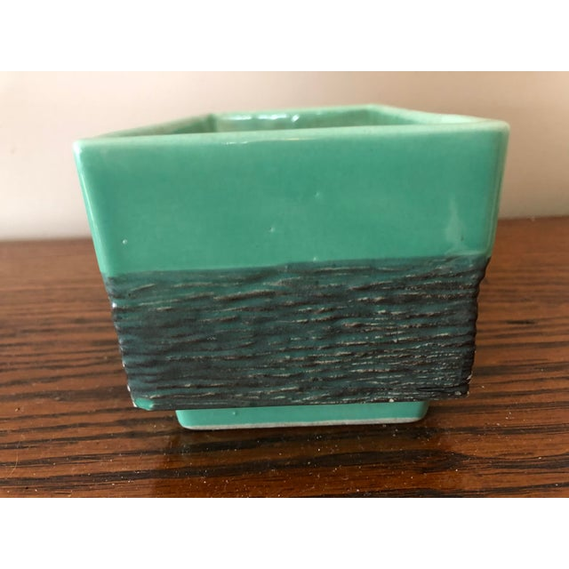 I love the unusual drip on this pottery which looks like galvanized metal. This piece blends nicely with other more...