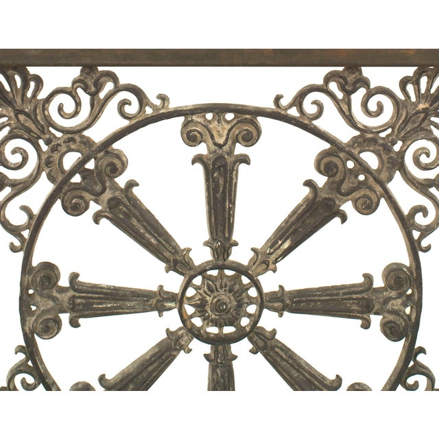 Outdoor continental style large iron base rectangular coffee table with a 19th century iron filigree railing as a shelf...