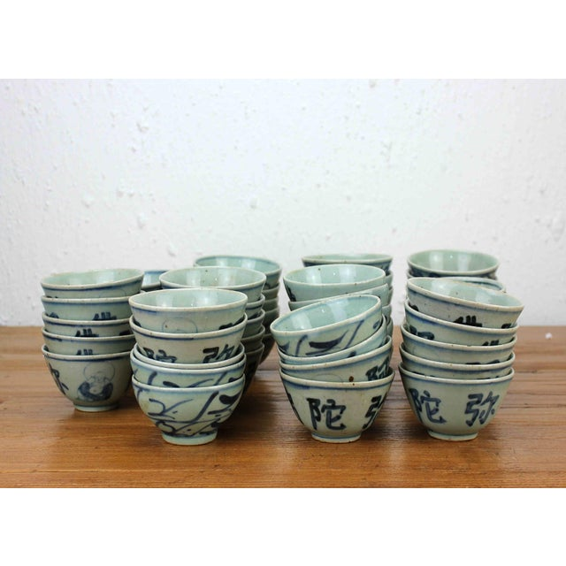 Estimated Retail Price: $1650. Ceramic blue & white set of 77 vintage cups. This is a unique one of a kind collection, and...