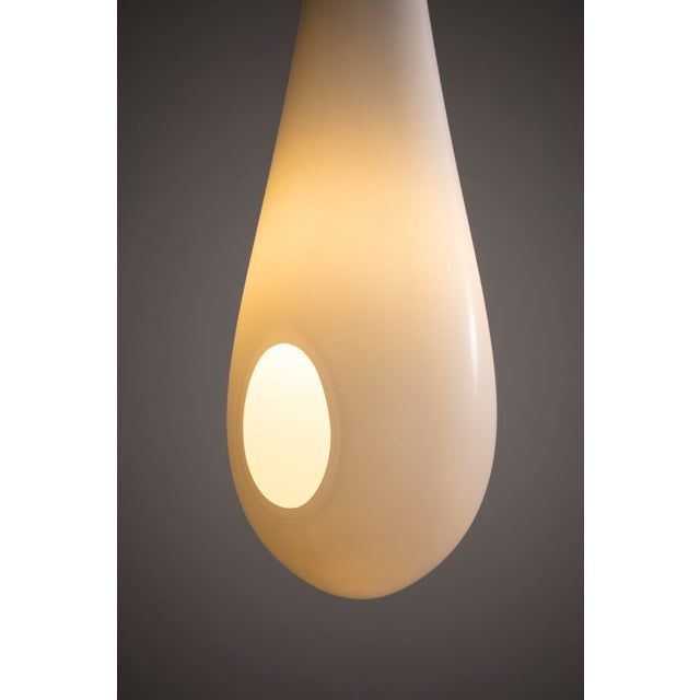 """Unique """"Milk Drop"""" illuminated sculpture in hand-blown glass with gray interior and white sanded exterior. Designed and..."""