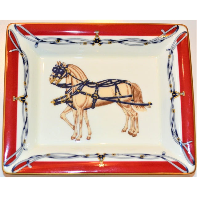 This is a vintage Daniel Hechter designer porcelain gentlemen's dresser tray circa 1980's. This tray features a beautiful...