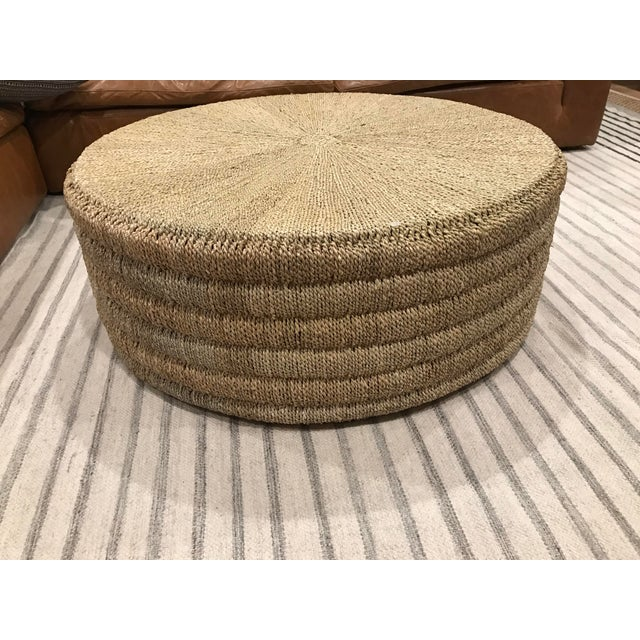 """""""Four Hands"""" Pandan rope, hand-woven in Indonesia, reveals its natural texture for a light, neutral look. Soft curves..."""