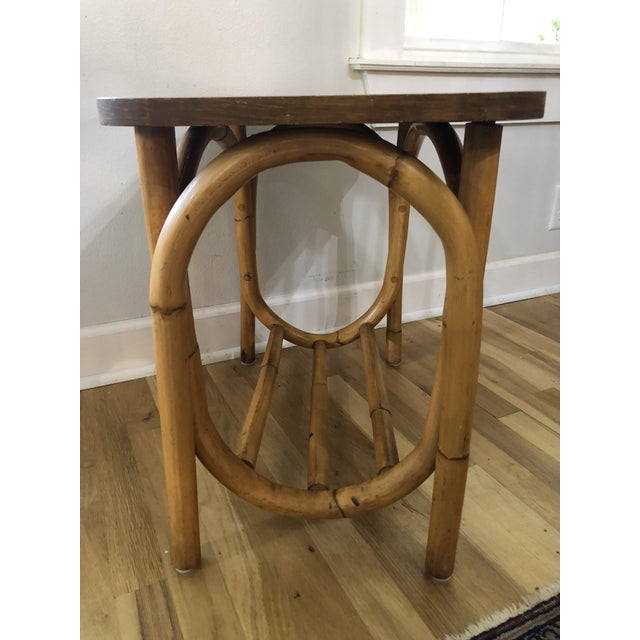 Here's an adorable little rattan side table, truly from the mid century. It's simple curves are similar to the style of...