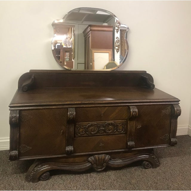 1920s walnut vanity with mirror and stool. There is a full bed frame with nightstands and a massive wardrobe that were...