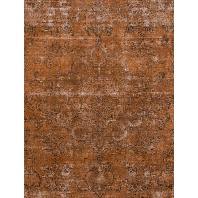 Vintage Persian hand-knotted overdyed rug with a medallion floral motif. This piece has great detailing and a beautiful...