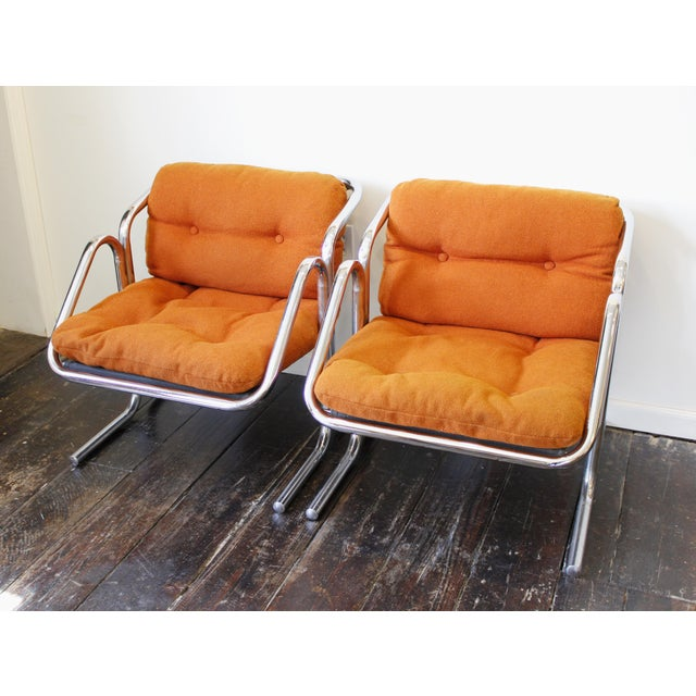Fantastic pair of Jerry Johnson Arcadia lounge chairs circa 1970s. Bent chrome construction with black canvas slings and...