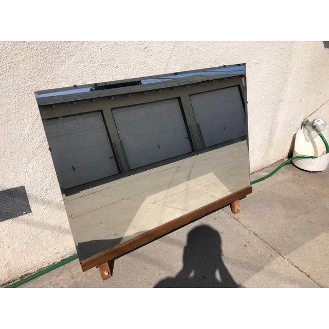 """A mid century modern walnut framed mirror made in the 1960's. The dimensions are: Mirror 44"""" wide and 1.5"""" deep and 31.5""""..."""