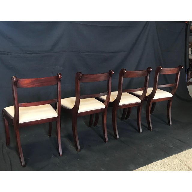 A set of four English Regency period brass inlaid dining chairs, circa 1815. Constructed of fine mahogany with beautiful...