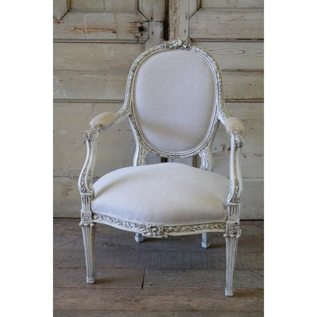 Lovely painted French chair in our signature oyster white finish, with subtle distressing, and finished with and antique...