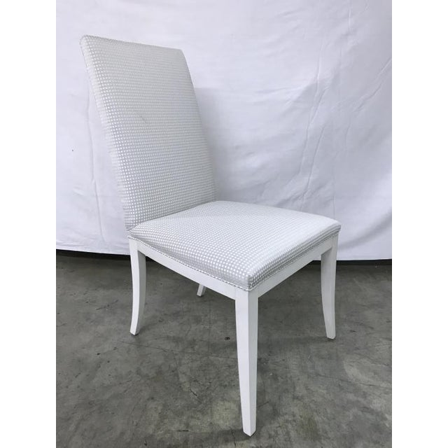 The Crosby Side Chair is a first quality market sample that features a White Fabric with an Oyster Finish.