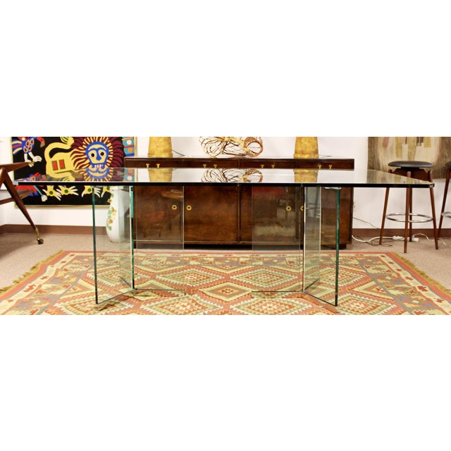 For your consideration is a stunning, Pace dining table, with a glass top and glass and chrome bases, circa the 1970s. In...