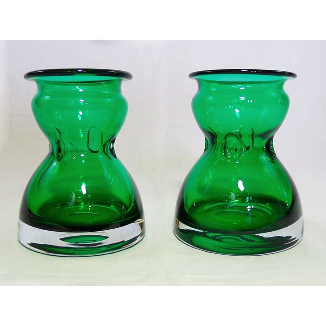 Pair of mid century deep emerald green bottle vases in pinched glass. Use these beauties as a center piece or accent on a...