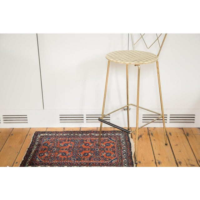 Small rug that stands out in the room! Featuring deep red and allover design, this little rug is incredibly timeless....