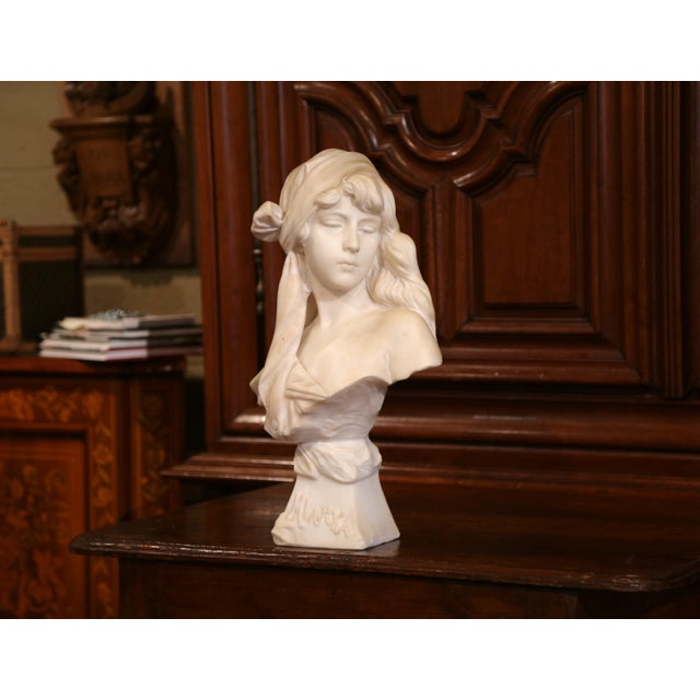 Place this elegant antique bust on a console or a pedestal; crafted in France circa 1880, the white carved bust features a...