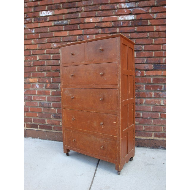 Unusual vintage handmade tall dresser with two top smaller drawers over four wide drawers. The rustic paint finish is a...