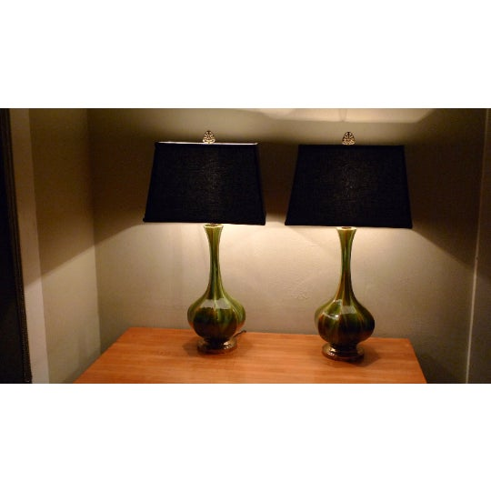 Table lamps of fluted, tapered blown glass, Murano style in multi-colors and design. Mid-century provenance. Offered and...