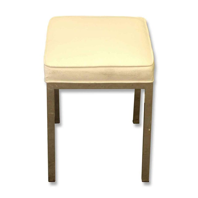 A small antique stool with steel legs and an upholstered seat. This piece is perfect for a modern, accent seating in the...