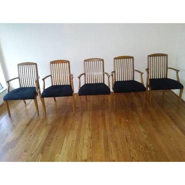 Set of five Henredon captains chairs for sale. All five chairs are in great shape. Black fabric on seats are in good...