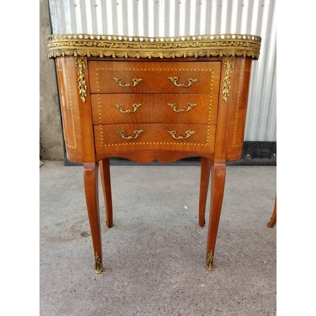 Two Louis XV style end tables with gilt ormolu, marquetry and marble tops. Excellent original condition. Made in Italy,...